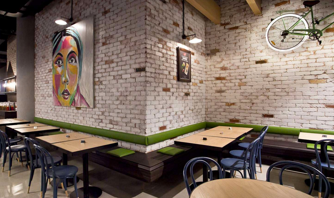 Roll'd Vietnamese, 140 Perth - Wall Hung Timber Bench in Metal Frame and Slatted Tassy Oak Timber Seat with Upholstered Backrest Attached to Wall.