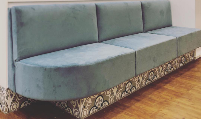 Fully Upholstered Low Backrest Banquette with Radius Corner