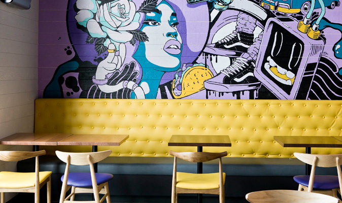 Taco Bell Midland - Upholstery for Custom Banquette Seating upholstered with Austex Encore Lemon Twist Vinyl with button detail